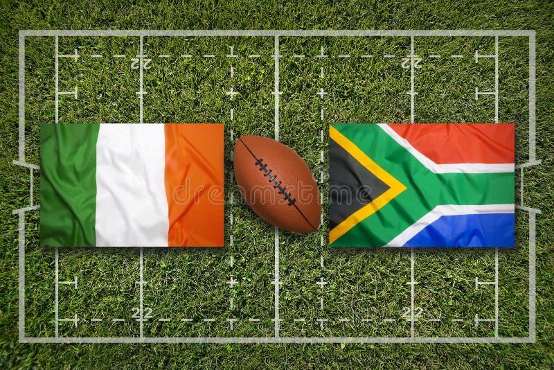 Ireland vs. ScotlandIreland vs. South Africa flags on rugby fi. Ireland vs. South Africa flags on green rugby field stock photography
