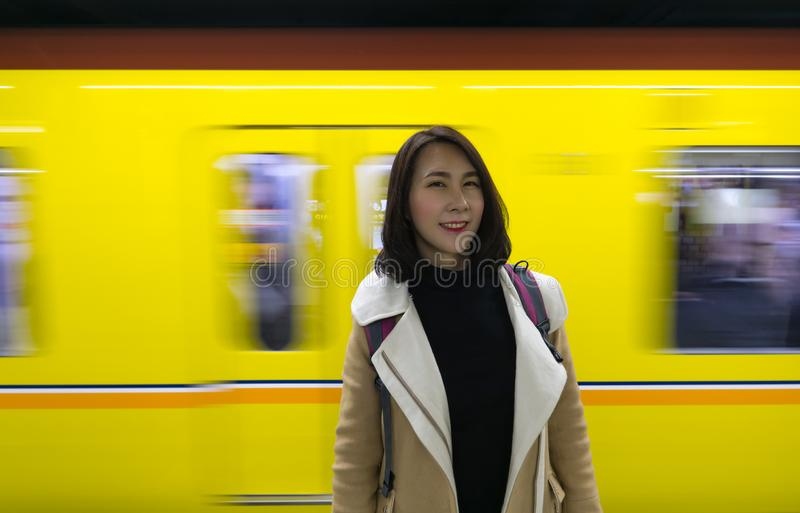 Irene Portrait with Train Background. Irene Portrait capture with the moving train as background. Camera aloft, capture the precious moment, a yellow train was stock photography