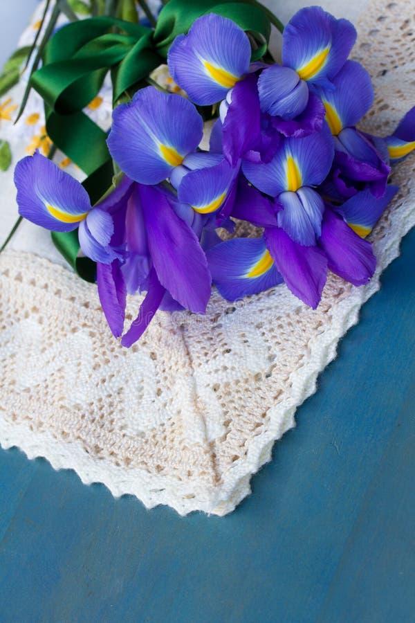 Iris flowers on blue table