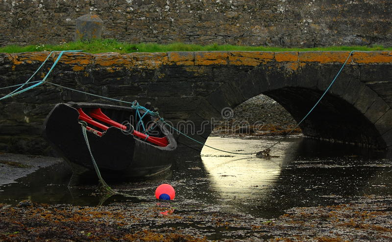 Irish boat at low tide. Colourful traditional wooden boat in Ireland(detail royalty free stock image
