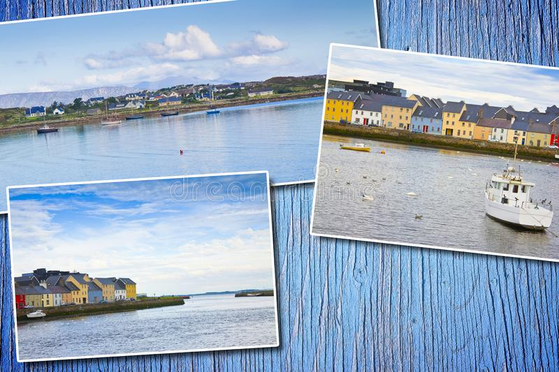 Irish coastal landscape with the typical colored fishermen`s houses - postards concept on colored wooden background royalty free stock photos