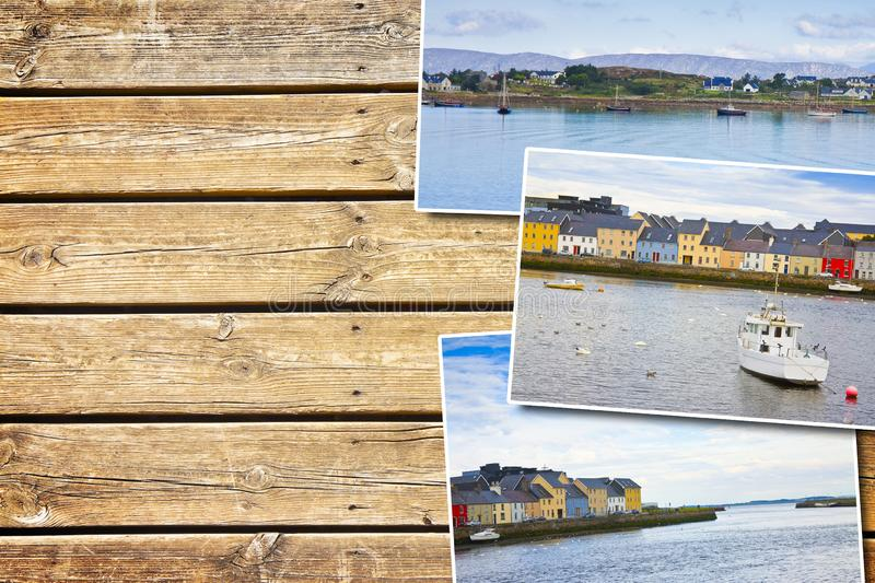 Irish coastal landscape with the typical colored fishermen`s houses - postards concept on colored wooden background stock photography