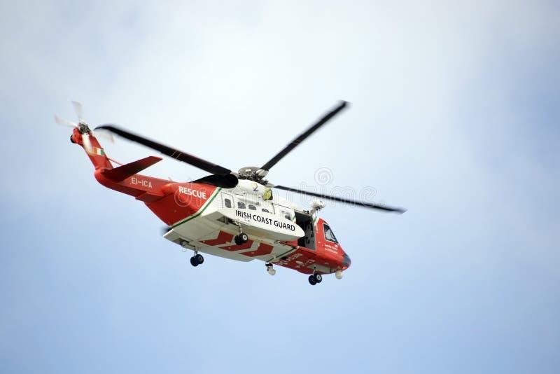 Irish coastguard rescue helicopter search. Irish coastguard rescue helicopter on search mission in the irish sky royalty free stock photography