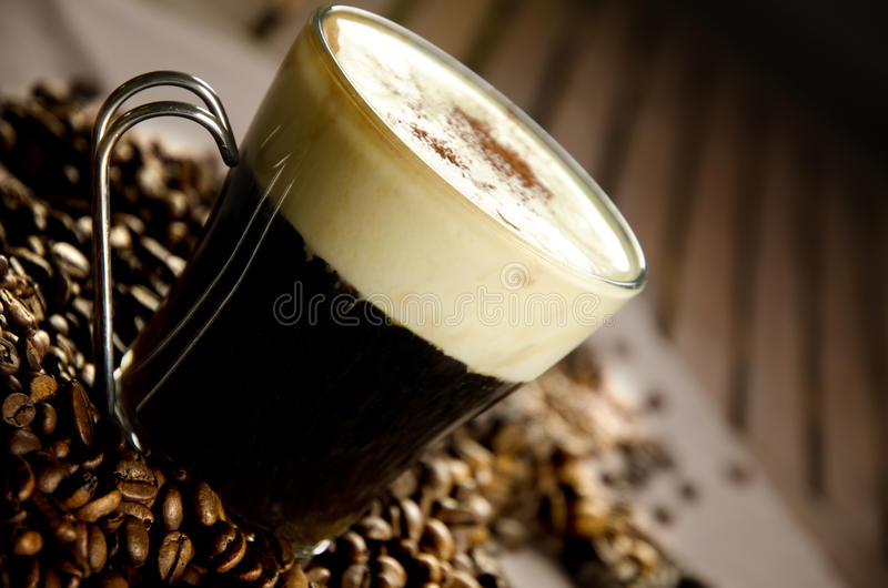 Irish coffee. Warm Irish Coffe with coffee beans, whiskey and cream
