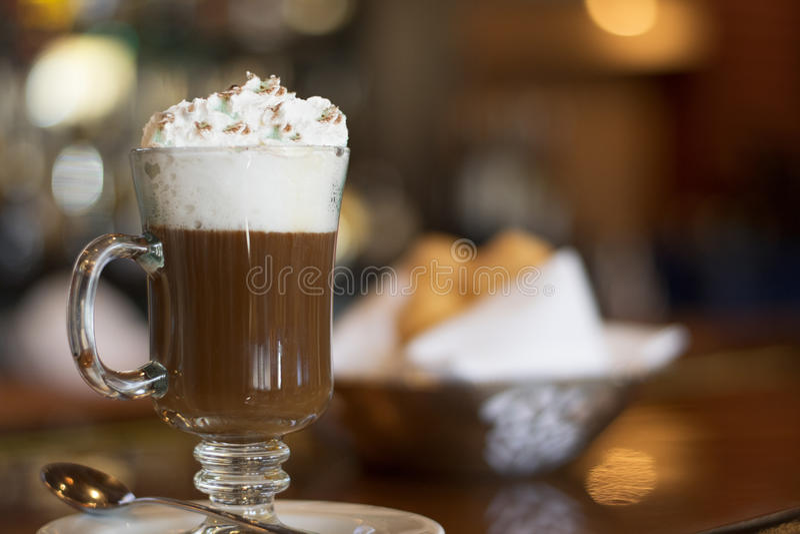 Irish Coffee. Over bar. Bokeh lights on background stock image