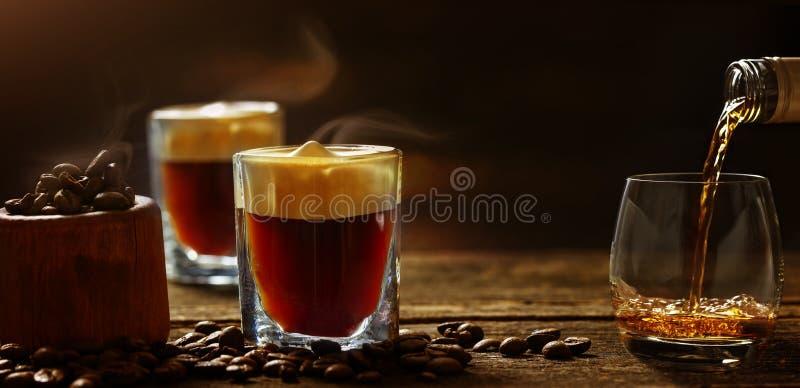 Irish coffee - coffee and whiskey against dark background royalty free stock photos
