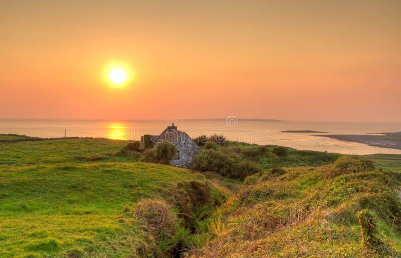 Irish cottage house at sunset stock photos