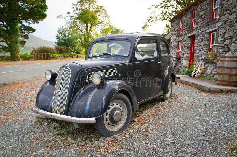 Irish cottage house with vintage car stock photo