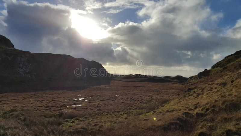 Irish countryside and sun with clouded sky royalty free stock photography