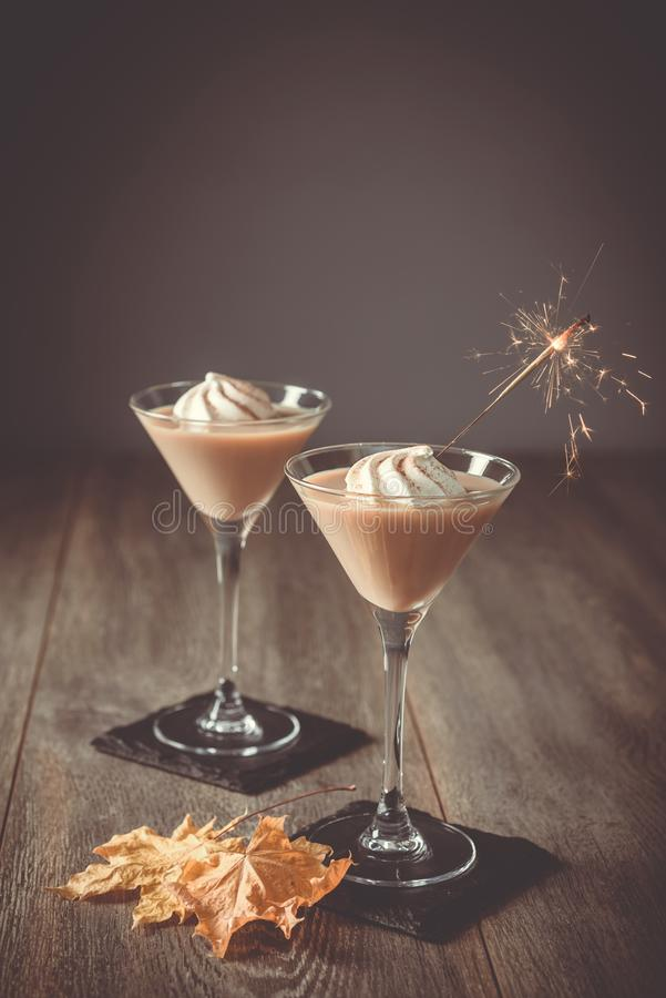 Irish Cream Liqueurs With Fall Leaves royalty free stock photography