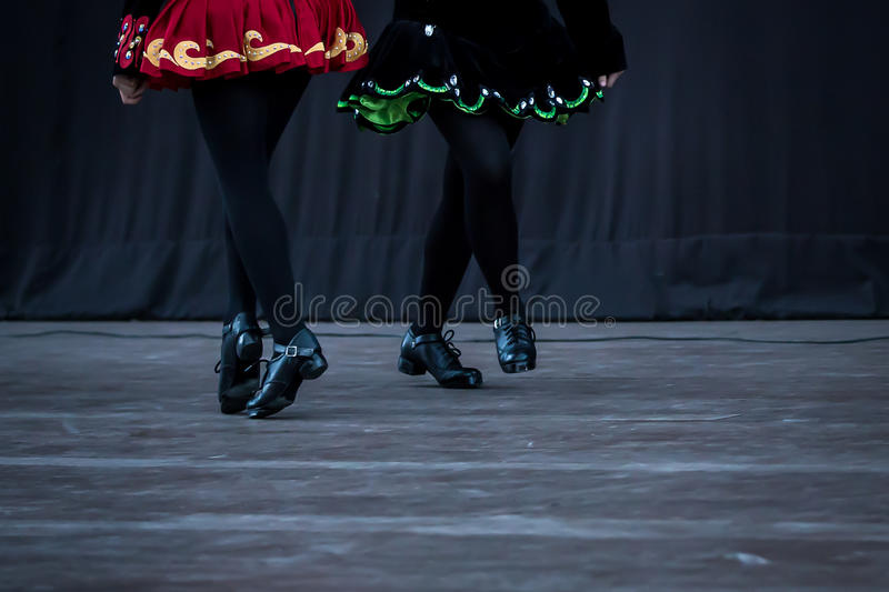 Irish Dancer Legs. Legs and feet of a female Irish dancer using the traditional Irish dancing hardshoes on parquet royalty free stock photos