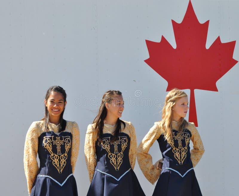Irish Dancers. And Canadian flag at Edmonton's Heritage Days stock photos
