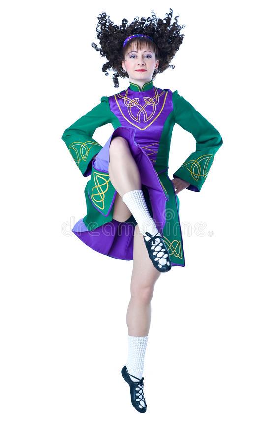 Irish dancing. Beautiful woman dancing irish dance on the white background stock photos