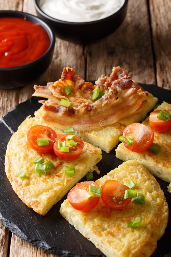 Irish food: potato pancakes Boxty with bacon, tomato and sauce c royalty free stock images
