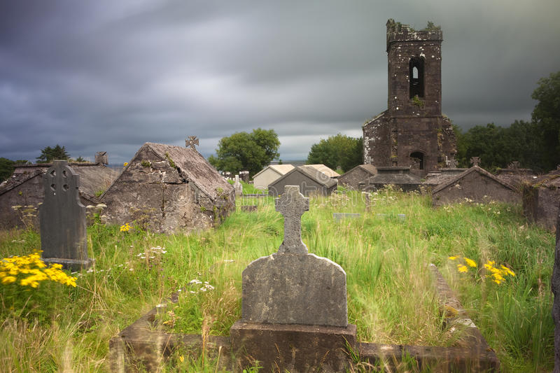 Irish graveyard cemetery dark clouds stock image