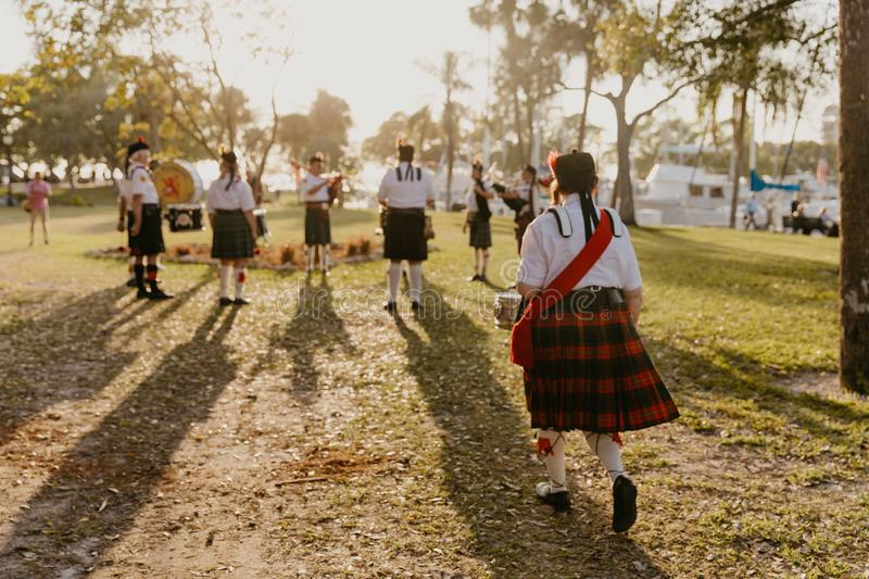 Irish Group of Bagpipe and Drummer Musicians Wearing Authentic European Kilts While Performing Traditional Celtic Music. In Scotland royalty free stock photos