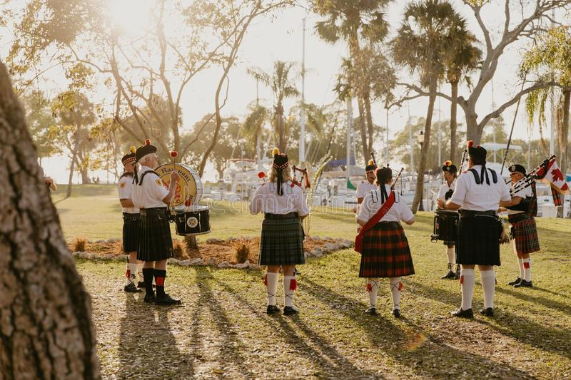 Irish Group of Bagpipe and Drummer Musicians Wearing Authentic European Kilts While Performing Traditional Celtic Music. In Scotland stock photos
