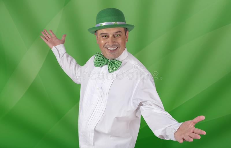 Irish Man With Cat`s Eyes Ready To Celebrate St. Patricks Day. An Irish Man posing as a Leprechaun, with green cat`s eyes ready to celebrate St. Patricks Day royalty free stock images