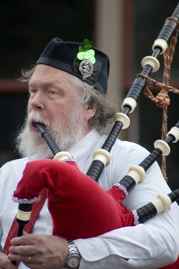 Irish Man Playing Bagpipes stock photos