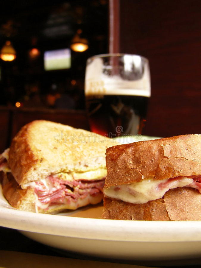 Irish Pub Lunch. Corned Beef sandwich and a pint of dark beer at an Irish pub royalty free stock image
