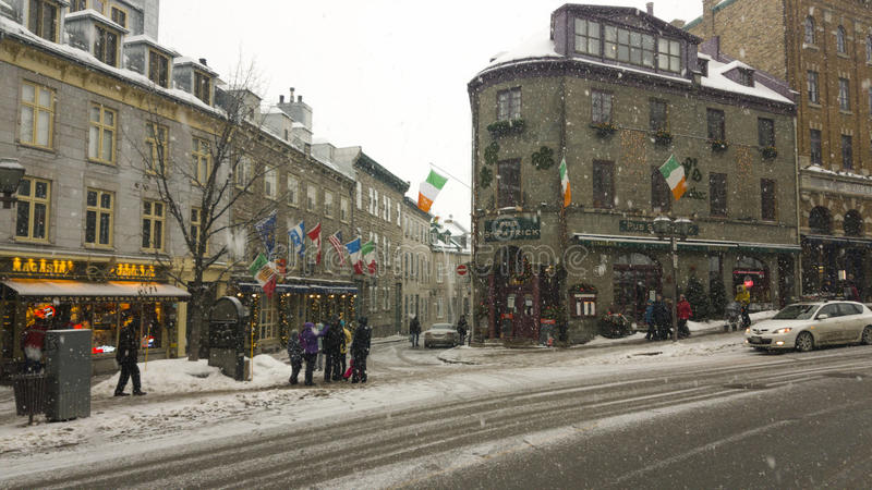 Irish pub Saint Patrick Quebec, Canada. Facade of pub on a winter day with snow at the streets of Quebec stock images