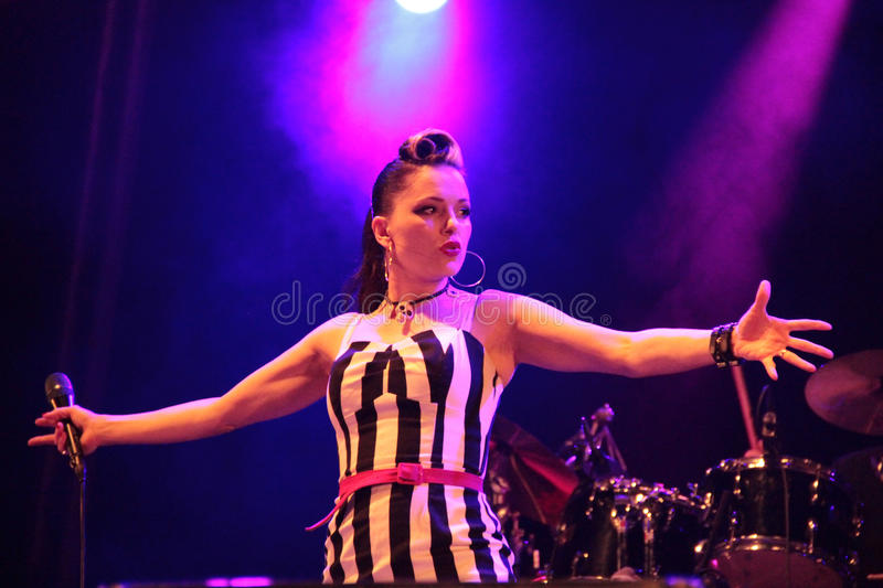 Irish rockabilly singer Imelda May during his show in Cruilla Barcelona Festival, July 12, 2014. BARCELONA, SPAIN - JULY 12, 2014: Irish rockabilly singer Imelda stock photography
