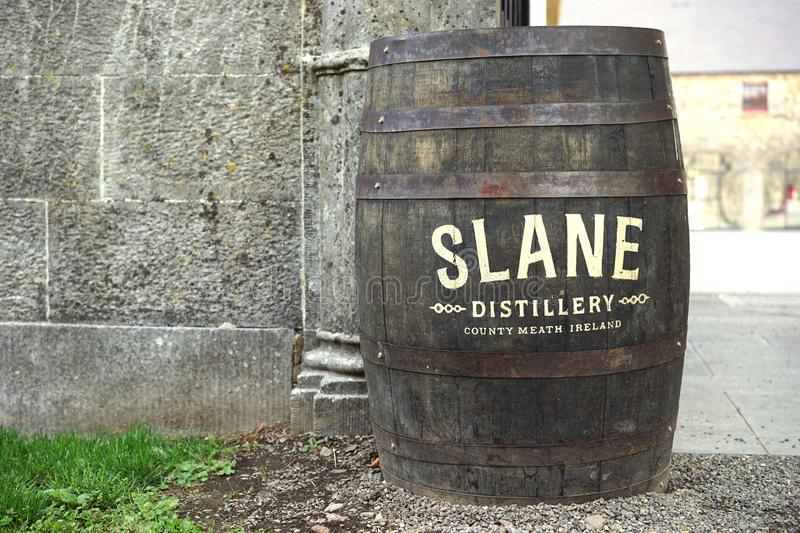 Irish whiskey rain barrel and advertising space. This water catchment barrel also serves to advertise for the local distillery in Slane, County Meath, Ireland royalty free stock image