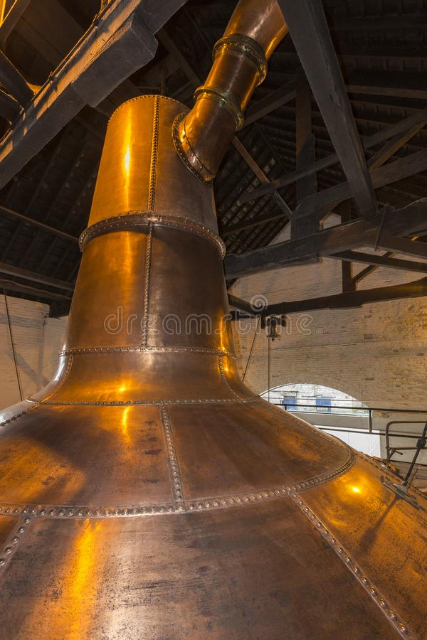 Irish Whisky Still in a Distillery - Ireland. An Irish copper pot still used in the production of Irish whisky. A still is an apparatus used to distill fermented royalty free stock photo