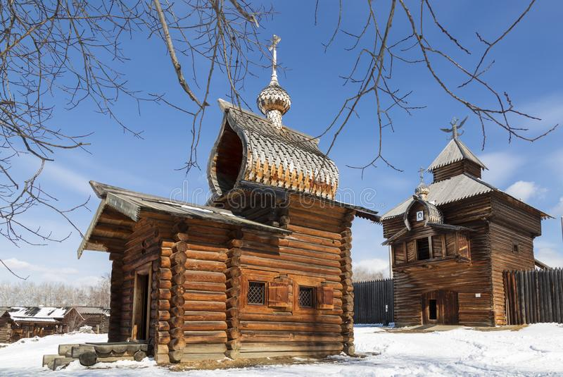Irkutsk architectural and ethnographic Museum `Taltsy`. .The Spasskaya Saviour tower of Ilimsk stockaded town, 1667 and Kazan. Church, 1679. The selo of Taltsy stock photo