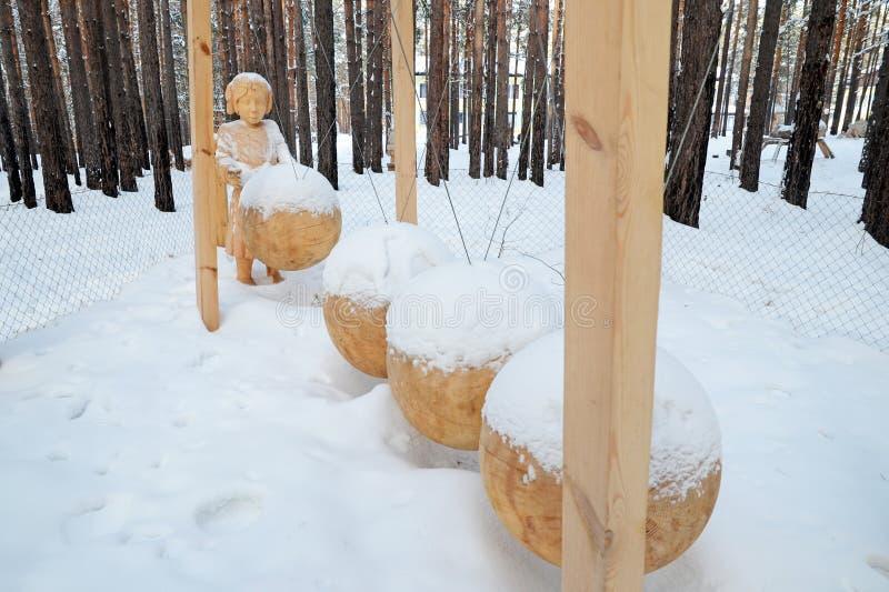 Irkutsk Region,Ru-Jan, 03 2015: The composition of Perpetuum Mobile. Park of wooden sculptures in Savvateevka Village royalty free stock photography