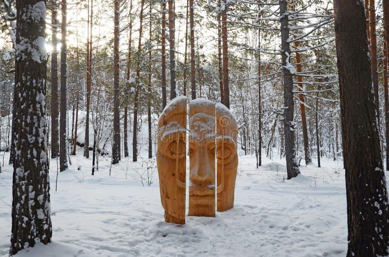 Irkutsk Region,Russia-Jan, 03 2015: Face of three parts. Park of wooden sculptures in Savvateevka Village stock photo