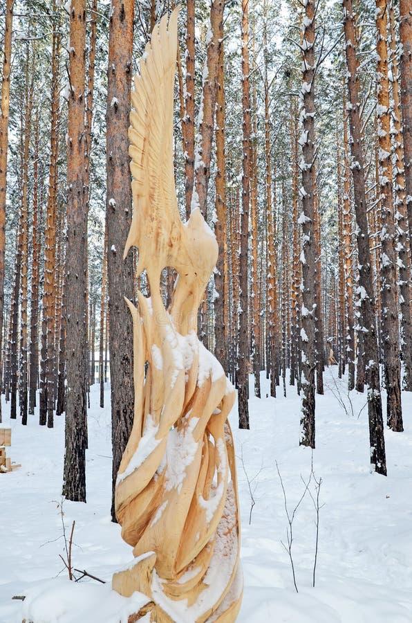 Irkutsk Region,Russia-Jan, 03 2015: Fairy forest bird. Park of wooden sculptures in Savvateevka Village stock photos