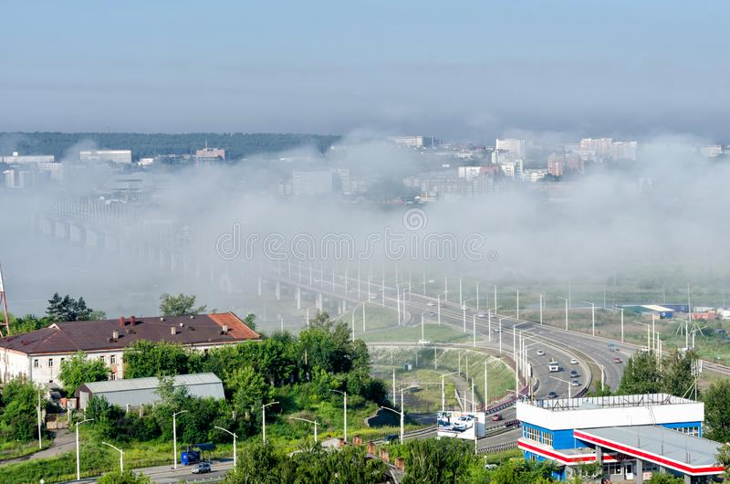 IRKUTSK, RUSSIA - July 8, 2013: Panoramic top view the city of Irkutsk on sunny summer day with fog stock photography