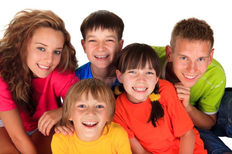 Irmãs e irmãos felizes foto de stock royalty free