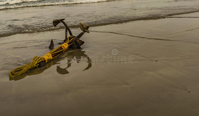 Iron Anchor of a small boat royalty free stock images