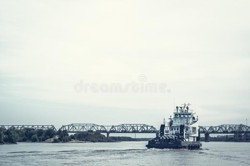 Iron barge and pusher tug boat on River. Large cargo barge transporting iron to main harbor for exporting along river. stock photos