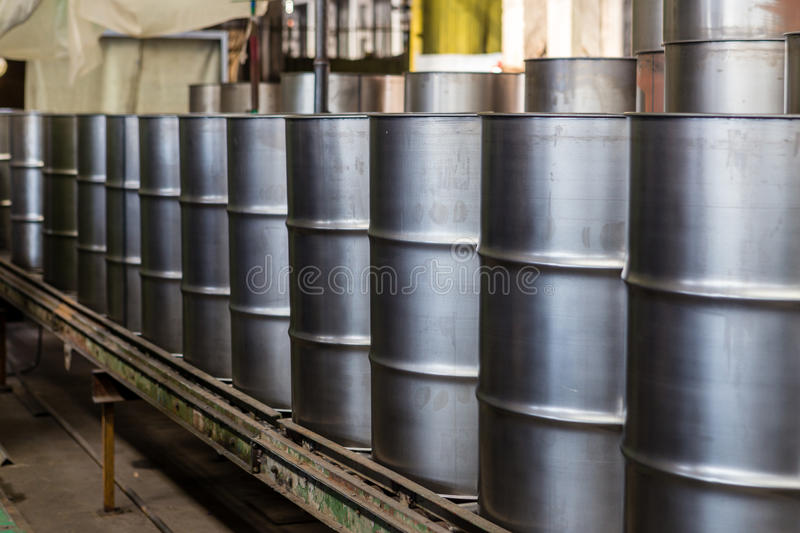 Iron barrels. Manufacture of steel drums conveyor royalty free stock images