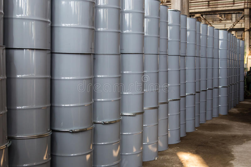 Iron barrels. Warehouse with new metal barrels royalty free stock images
