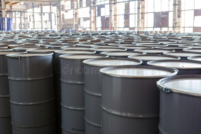 Iron barrels. Warehouse with new metal barrels royalty free stock photo