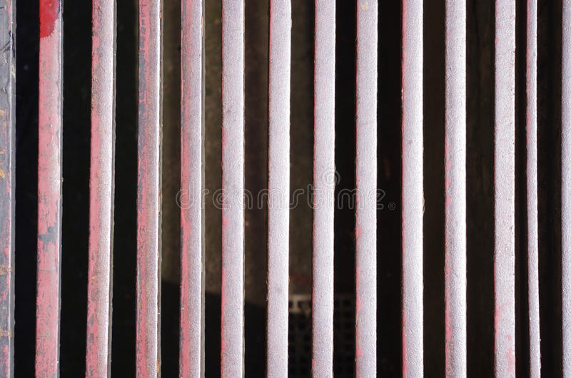 Iron bars background texture. Background texture of thin vertical iron bars royalty free stock photography
