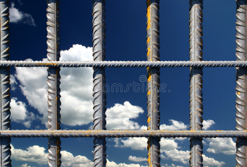 Iron bars on a blue sky stock images