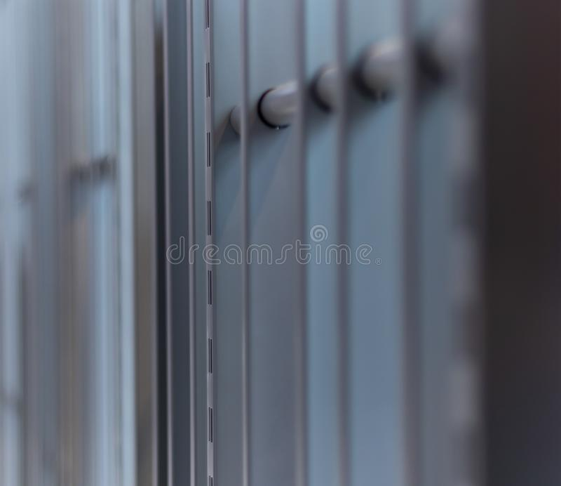 Iron bars, metal grating or prison cell, bright blurred outdoor background. Jpg royalty free stock image