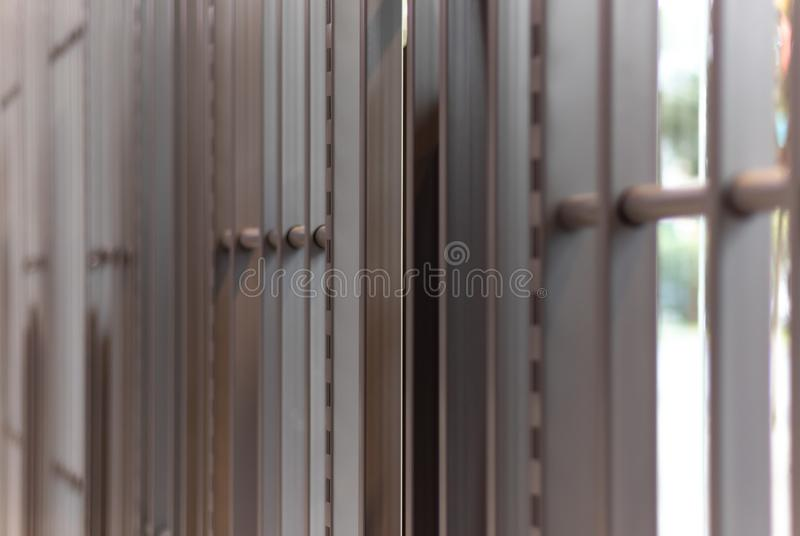 Iron bars, metal grating or prison cell, bright blurred outdoor background. Jpg royalty free stock photo