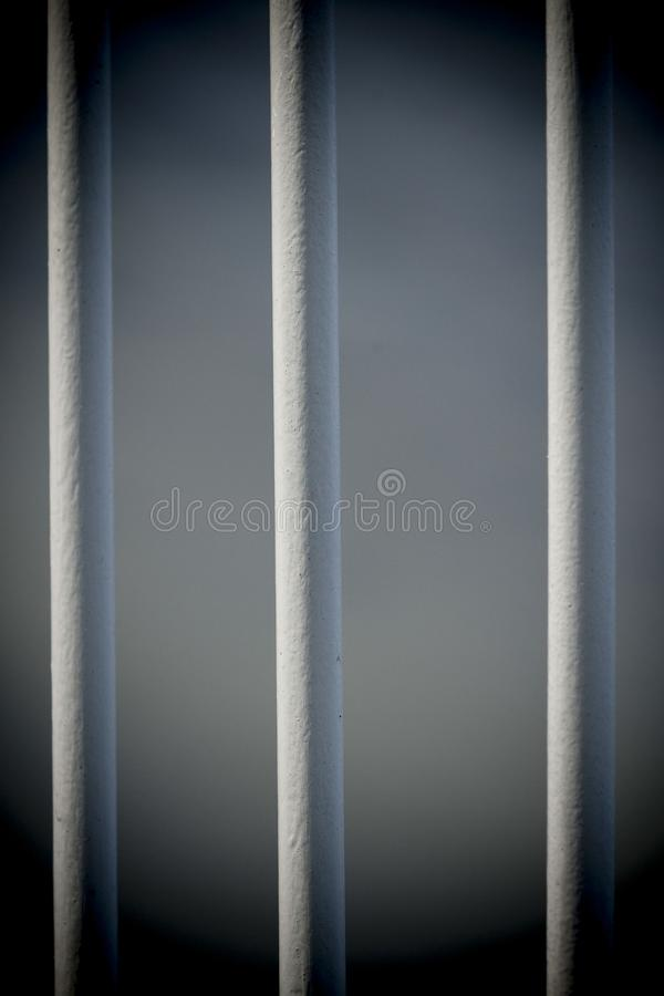 Iron bars, prisoners behind are locked up. Safety first, prison iron bars keep burglars in the cell stock photos
