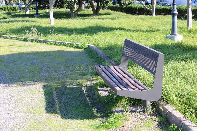 Iron bench with wooden seat royalty free stock image
