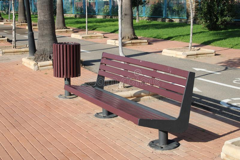 Iron bench with wooden seat royalty free stock photography