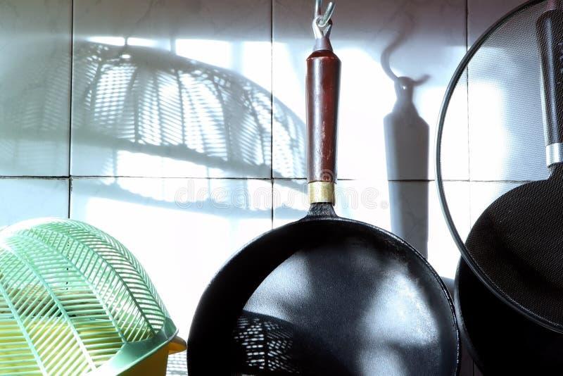 Iron black pan hunging in the kithen. Kitchen stuff. Cast-iron pan. Iron pan hunging in the kithen. Kitchen stuff. Cast-iron pan stock photography