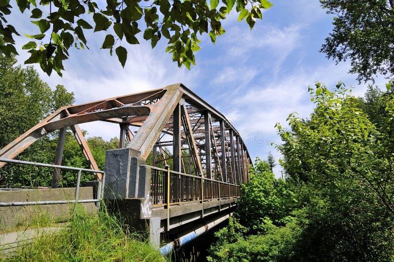 Iron bridge across Coquitlam River, British Columbia stock photos