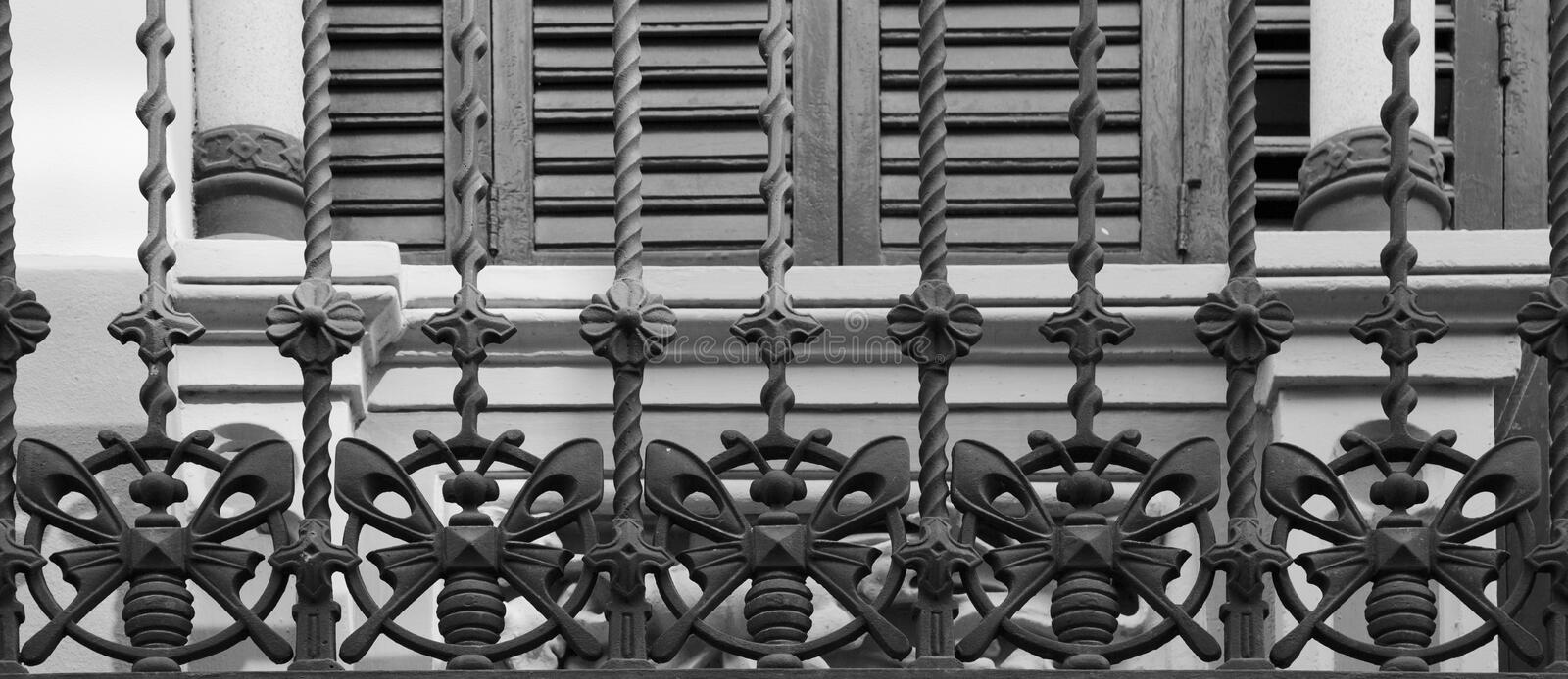 Iron butterflies on the balcony´s fence stock photography