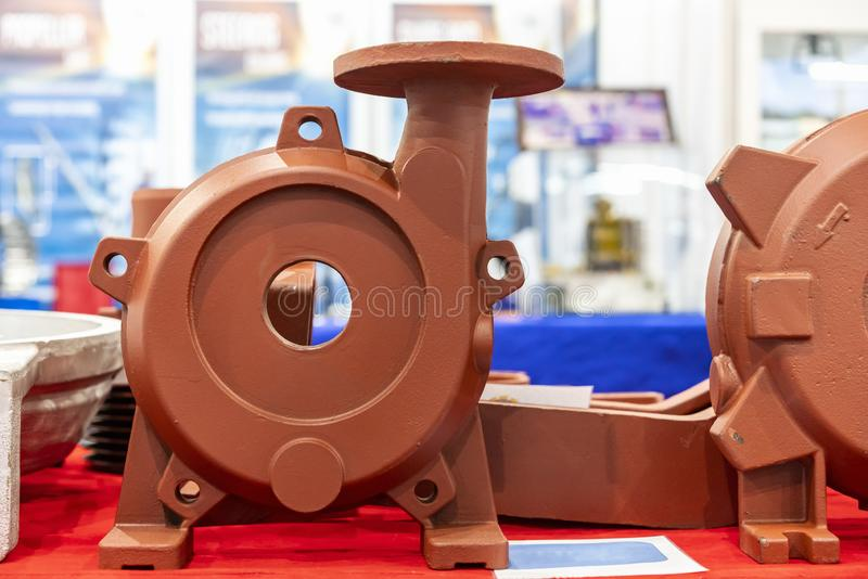 Iron casting parts housing pump or blower casting by green sand or shell mold process on red table stock photos